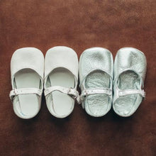 Load image into Gallery viewer, white leather crib shoes, single strap, next to silver leather crib shoes, single strap