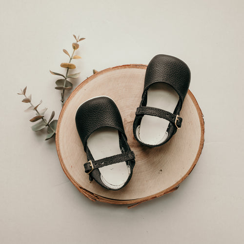 navy leather crib shoes, beige sole, single strap