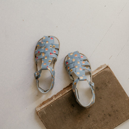 blue leather sandal with emoji pattern