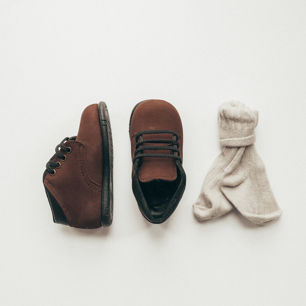 chocolate nubuck, first walker, leather boots, black laces, black sole, black cuff around top of shoe