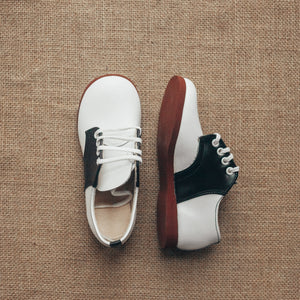 black and white leather saddle shoes, white laces, red crepe sole