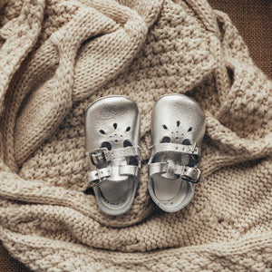 silver leather crib shoes, two straps, petal shaped holes, white insides