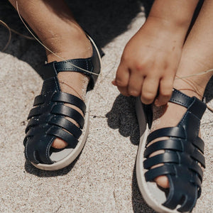 navy leather sandal with beige sole