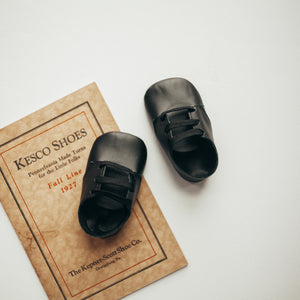 black leather crib shoes, black laces