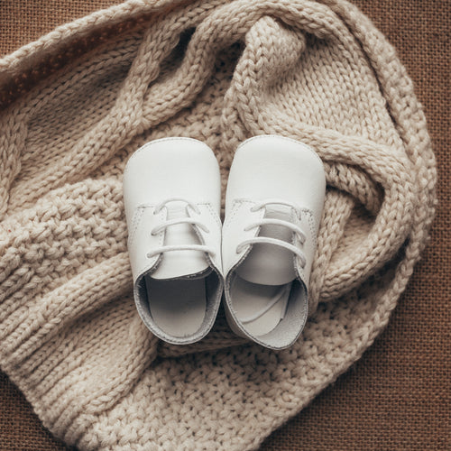 white leather crib shoes, white laces