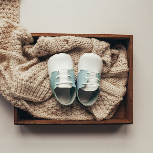 white and light blue leather crib shoes, white laces
