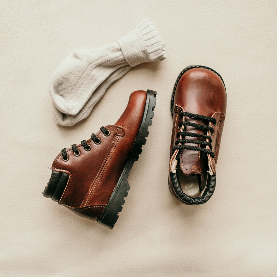 brown leather boot, black sole, black laces