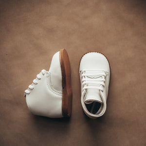 white leather first walker, brown sole, white laces, beige inside
