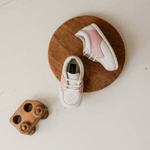 white and pink leather saddle shoe