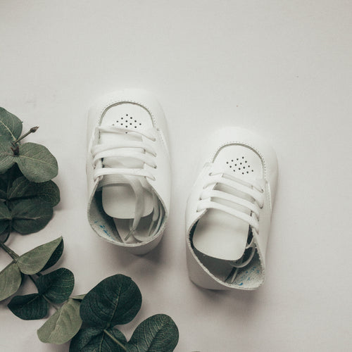 white leather crib shoe, white laces