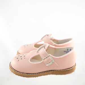 pink leather t-strap, light brown sole, single strap, petal shaped holes