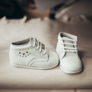 white leather first walker, boots, white laces, cutout hearts on outer side of shoe, white sole