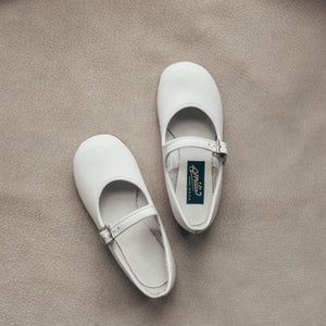 white leather mary jane, white sole, single strap