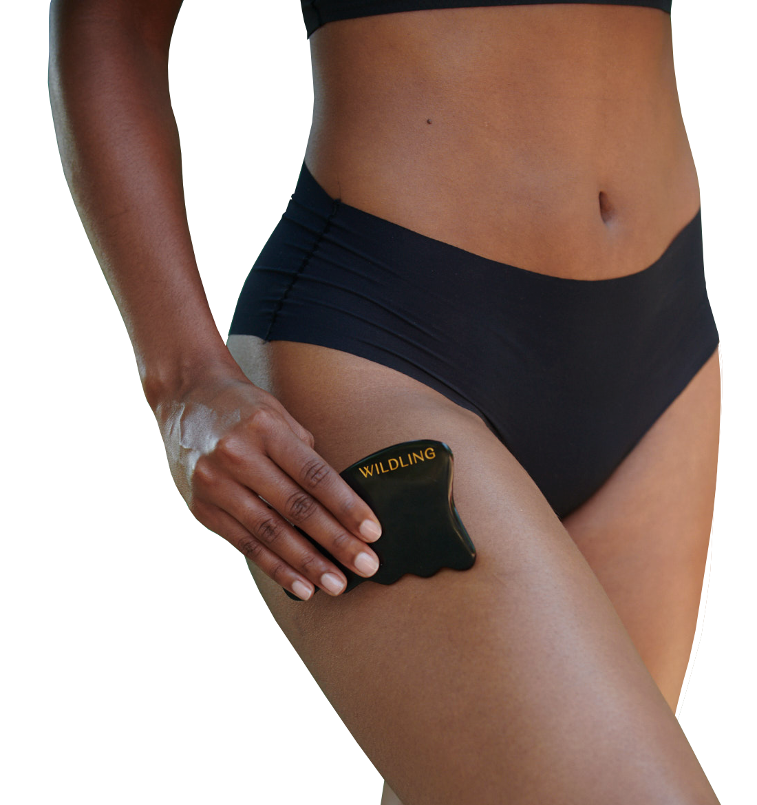 Woman using Aura stone on thigh