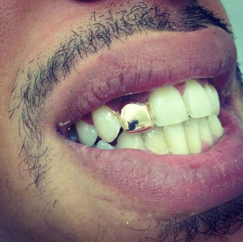 one tooth silver grillz