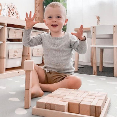 Child-building-with-wooden-blocks