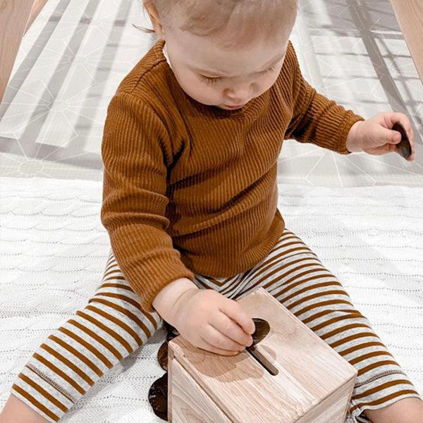 Child playing with posting toy
