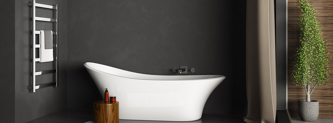 Image of a bathtub in a bathroom with black wall and a heated towel ladder in chrome