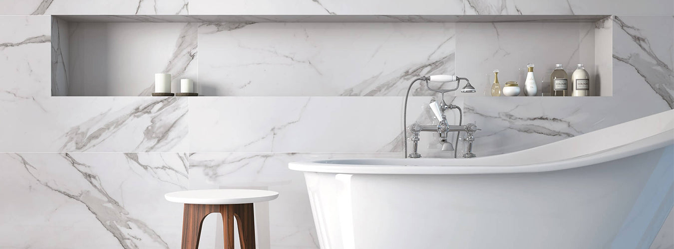 Forme bathroom with marble tiling and traditional style tapware in chrome