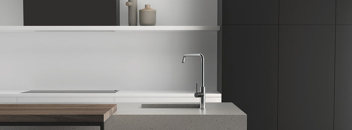 Phoenix Tapware Toi Sink Mixer in a Kitchen with a grey benchtop and black cabinetry