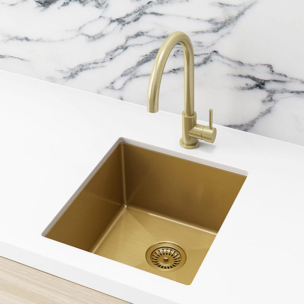 Meir Single Bowl PVD Kitchen Sink 440mm - Brushed Bronze Gold Featured in a Kitchen on a White Benchtop with a Marble Splashback- The Blue Space