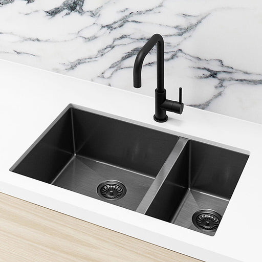 Meir Single Bowl PVD Kitchen Sink 670mm - Brushed Gun Metal Featured on a White Kitchen Benchtop and Marble Splashback with a Squared Off Sink Mixer - The Blue Space