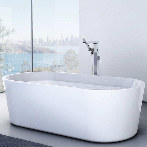 Caroma Aura Freestanding Bath by Caroma in luxury bathroom - The Blue Space