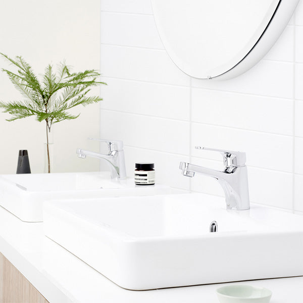 Dorf Kip Basin Mixer Featured in a Bathroom On a White Semi-Inset Basin - The Blue Space