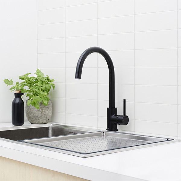 Dorf Poseidon Sink Mixer-Matte Black Featured in a Kitchen On a White Benchtop - The blue Space