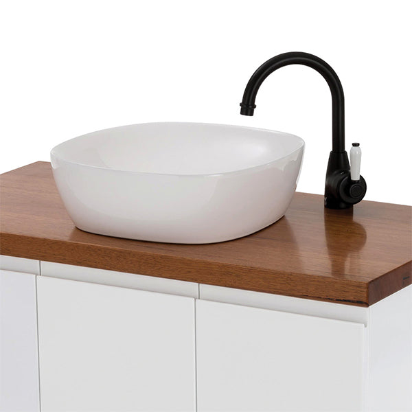Fienza Eleanor Gooseneck Basin Mixer - Matte Black/Ceramic on a wood top vanity with white basin lifestyle image