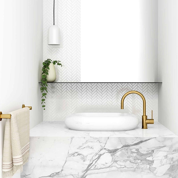 Seima Paxi Above Counter Basin Featured in a Marble Bathroom with a Gold Basin Mixer