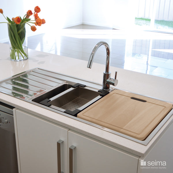 Seima Kubic 1.75 Double Bowl Kitchen Sink featured in a kitchen with white benchtop and chopping board cover