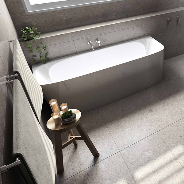 Seima Fotia Back To Wall Freestanding Bath featured in a bathroom with grey tiling