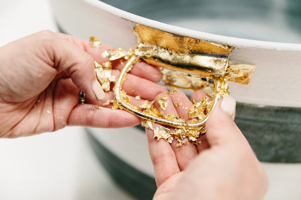 Gilding is an easy, quick way to give new life to your hardware, whether it's on a dresser, cabinets, or a decorative piece with knobs or knockers.
