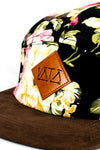 Pink, green, and black floral five-panel hat with brown flatbrim