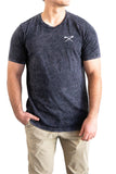 Man wearing dark grey mineral wash t-shirt with Fijian war club logo