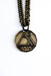 Bronze colored necklace on chains with mountain logo and island logo