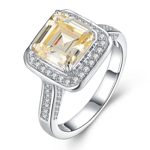 Silver square yellow zircon ring