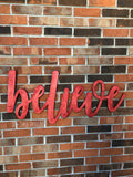 Large wooden Believe sign