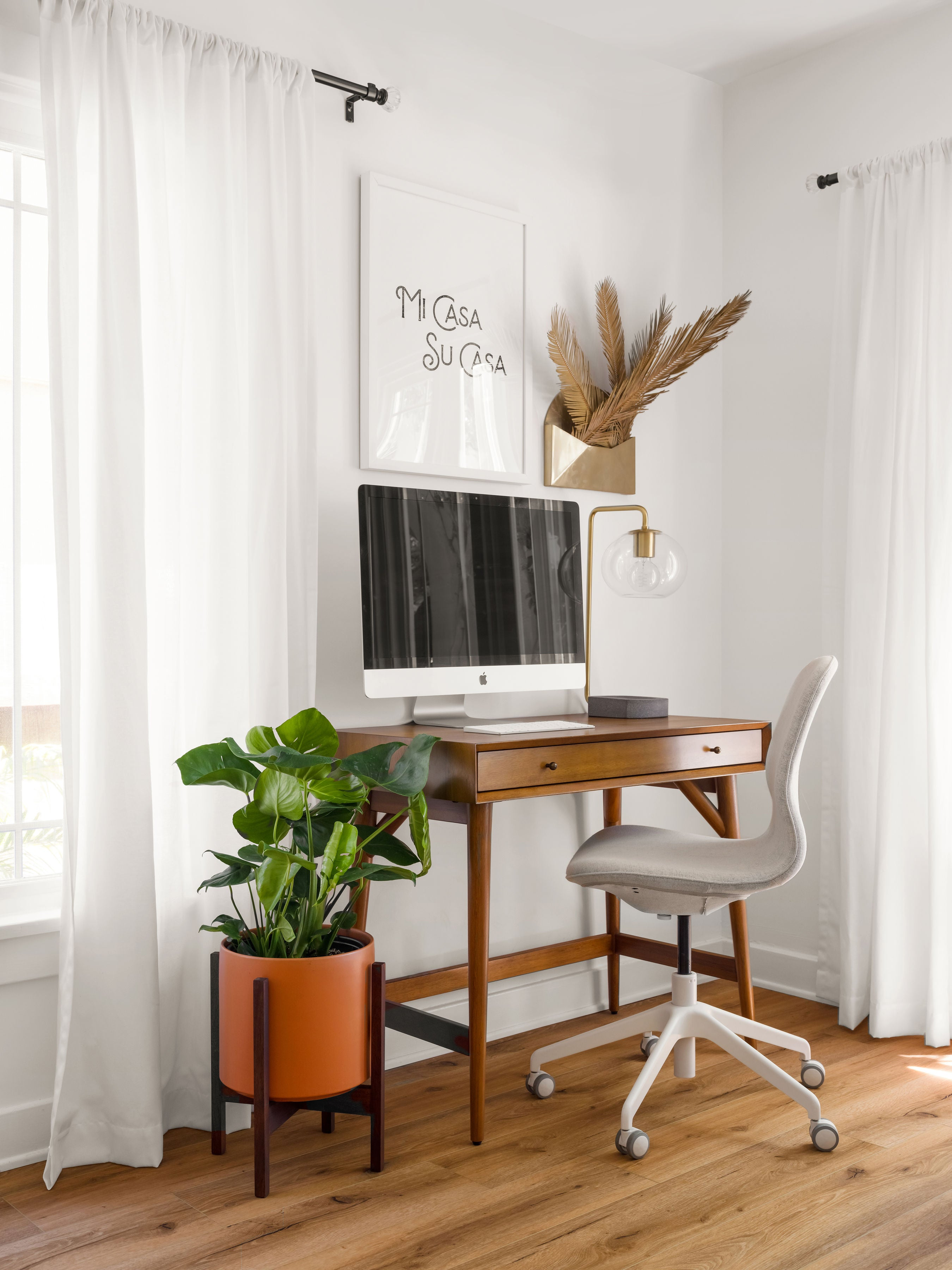 Image of Home Office with MidCentury Modern Ceramic Cylinder Planter next to Desk with Computer Monitor