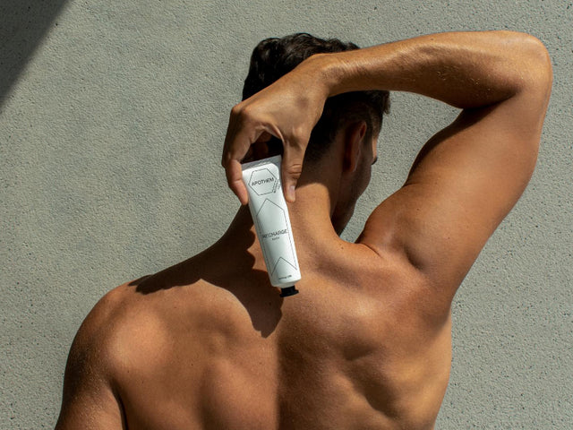 Man holding APOTHEM Recharge CBD cream for muscle relief
