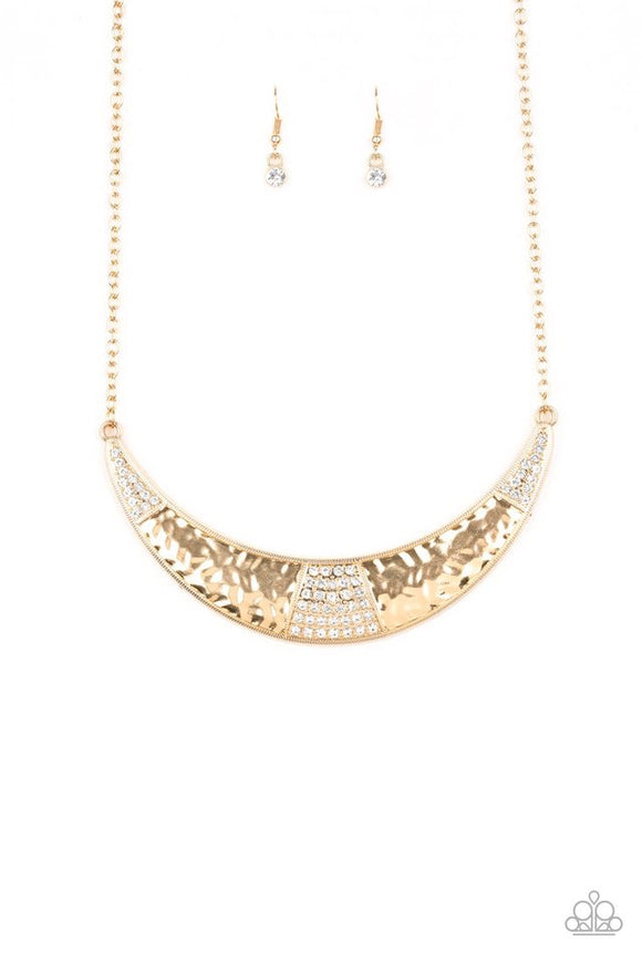 Featuring a shimmery hammered finish, a glistening gold half-moon plate is encrusted in sections of glassy white rhinestones, creating a blinding statement piece below the collar. Features an adjustable clasp closure.  Sold as one individual necklace. Includes one pair of matching earrings.