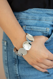 Paparazzi Treasure Cache - Silver - Hammered Shimmer Silver Discs - Stretchy Band Bracelet