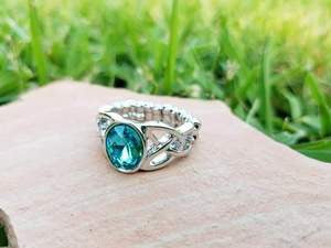 A glittery blue gem is pressed into the center of a shimmery silver band rippling in a filigree pattern for a refined look. Features a dainty stretchy band for a flexible fit.  Sold as one individual ring.  *All Paparazzi Accessories items are nickel free and lead free.