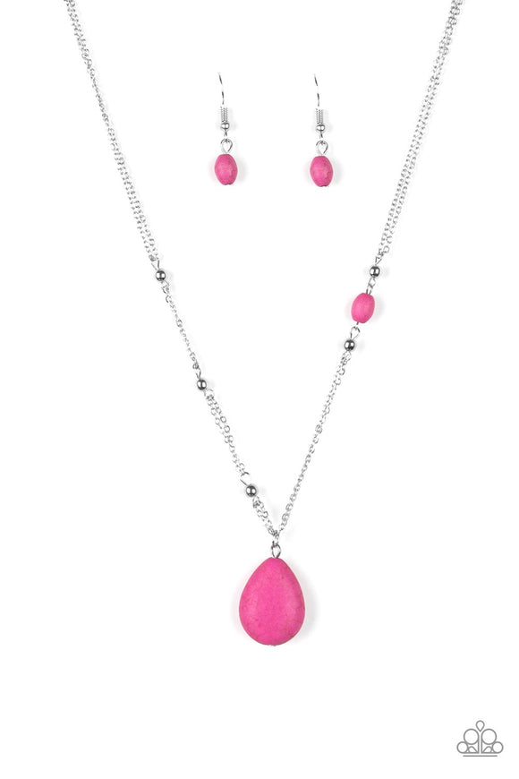 Dotted with shimmery silver beads and a dainty pink stone, shimmery silver chains give way to a vivacious pink teardrop pendant below the collar for a seasonal look. Features an adjustable clasp closure.