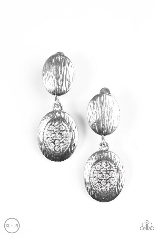 Runway Radiance White Clip-on Earrings - Glitzygals5dollarbling Paparazzi Boutique