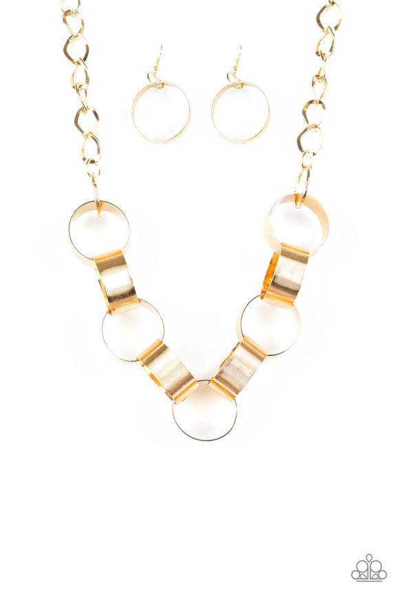 Paparazzi Big Hit - Gold - Links connect below the collar - Bold Necklace and matching Earrings