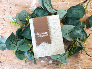 Bon Voyage | handmade birthday card | faded vintage map background with chocolate brown banner on left side, sentiment: Birthday Wishes | Thoughtfully Handmade