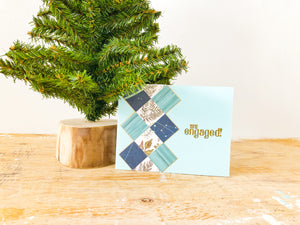 Happily Ever After | handmade congratulations engagement card | ice blue background with blue & white argyle pattern on left side | you're engaged sentiment | Thoughtfully Handmade