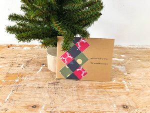 Holiday Argyle Madness | handmade Christmas card | kraft background with red, blue & green argyle pattern on left side | with love from all of us eat.drink.be merry sentiment | Thoughtfully Handmade